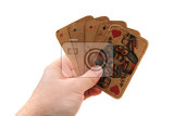 Fotografia old poker cards in my hand isolated on the white background