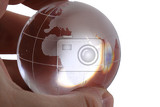 glass earth globe in human hand isolated on the white background