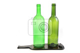 Fotografia green glass bottles with one flat bottle isolated on the white background