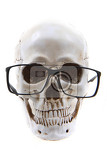 Photo human skull with glasses isolated on the white background