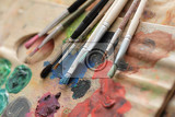 paint brushes and color on the palette background