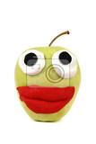 Photo green apple with plasticine smile isolated on the white background