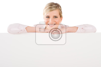 Businesswoman leaning over empty banner