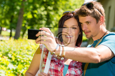 Young couple in love take picture themselves