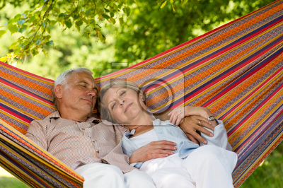 Senior couple relax sleeping in hammock