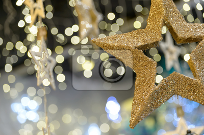 Star Christmas ornament on blurred background