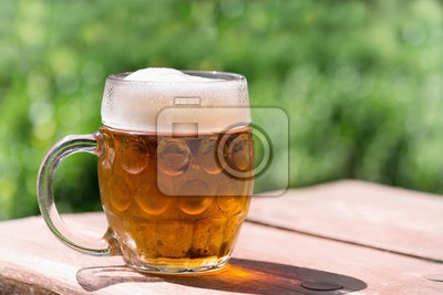 glasses of beer on a wooden table