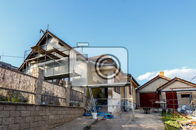 construction or repair of the rural house fixing facade insulation and using color