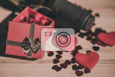 valentines day bottle of vine red hearts and small present a retro style