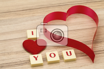 valentines paper hearts on a wooden background  valentines day  day valentine postcard with scrabble text i love you