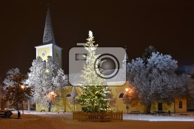 beautiful night winter photo christmas tree with church and snow
